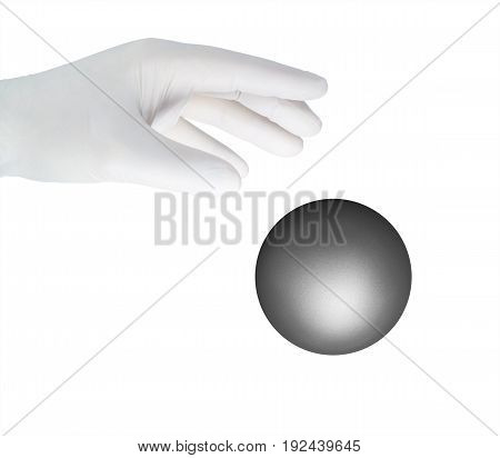 A hand in a white glove grabs a silver ball.
