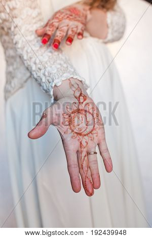 Women's hands, drawings of henna, Vedic symbols and patterns, moon