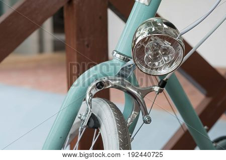 retro vintage bicycle headlight closeup. green bicycle