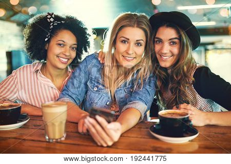 Three Attractive Smiling Young Women Friends