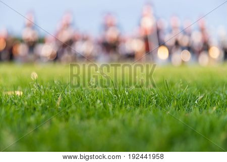 Details from a music show and marching band. Defocused background with grass and evening sun to use as Background