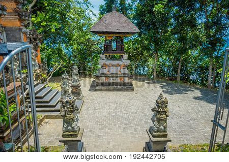 BALI, INDONESIA - MARCH 05, 2017: Stoned statues in the enter of Pura Ulun Danu Bratan is a major Shivaite and water temple on Bali island, Indonesia.