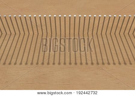 row of nails hammered in the clear wood with a shadow 3d rendering