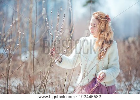 Beautiful walking woman in a spring park