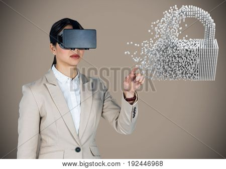 Digital composite of Business woman in VR touching 3D lock graphic against brown background