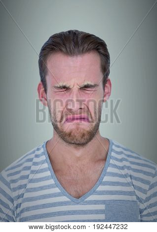 Digital composite of Man crying against light blue background