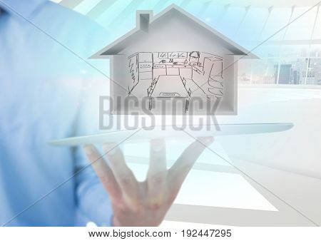 Digital composite of house with draw of kitchen in tablet with blue lights