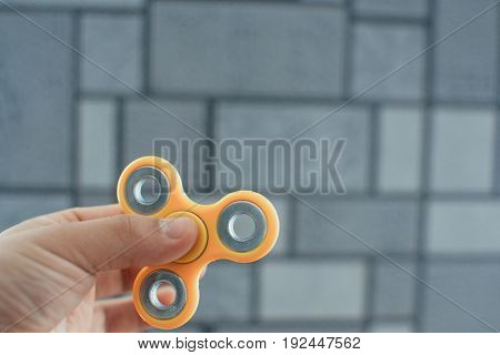 Yellow Fidget Spinner In Male Hand, Selective Focus