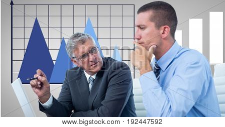 Digital composite of Businessmen discussing against graph in office
