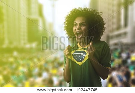 Latina woman holding Brazilian flag in Sao Paulo
