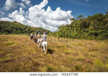 People riding on horses in Matutu, state of Minas Gerais, Brazil