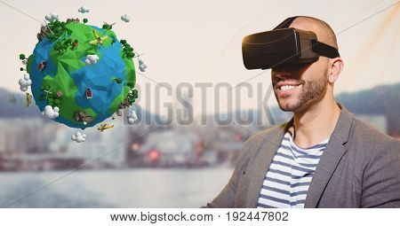 Digital composite of Smiling man looking at low poly on VR glasses