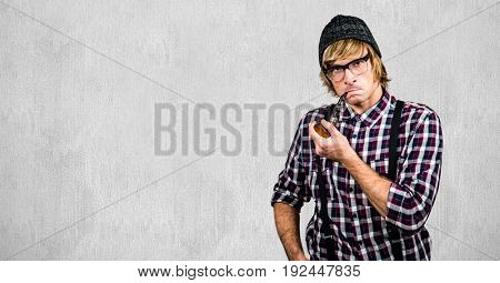 Digital composite of Male hipster smoking pipe against wall