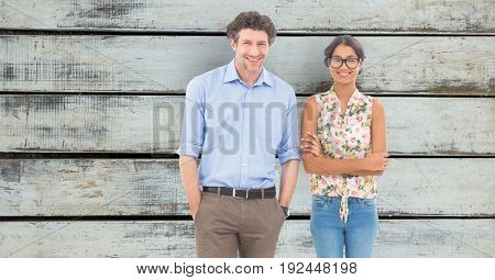 Digital composite of Confident business people standing against wooden wall