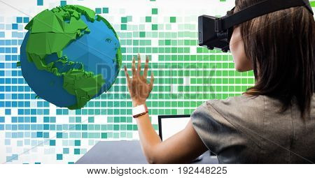 Digital composite of Woman looking at low poly on VR glasses