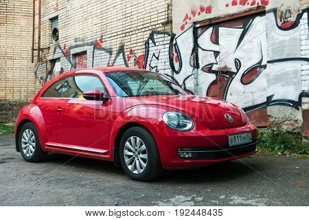 Smolensk, Russia - May 28, 2017: New beautiful red Volkswagen Beetle (Kafer) parked in the street. Manufactured and marketed by German automaker Volkswagen (VW) from 1938!