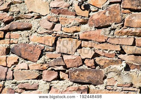 Wall made of granite stones as background .