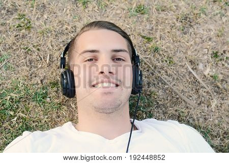 Man Listening To Music With Headphones.