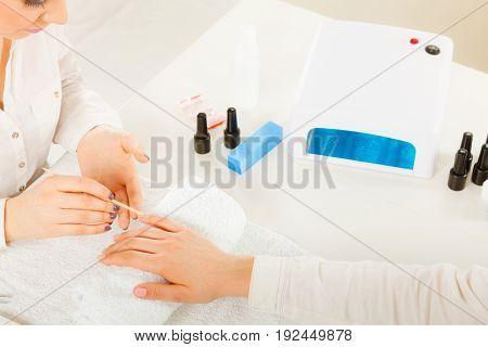 Beautician Preparing Nails Before Manicure, Pushing Back Cuticles