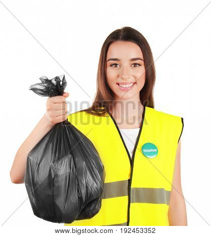 Beautiful young volunteer with garbage bag on white background