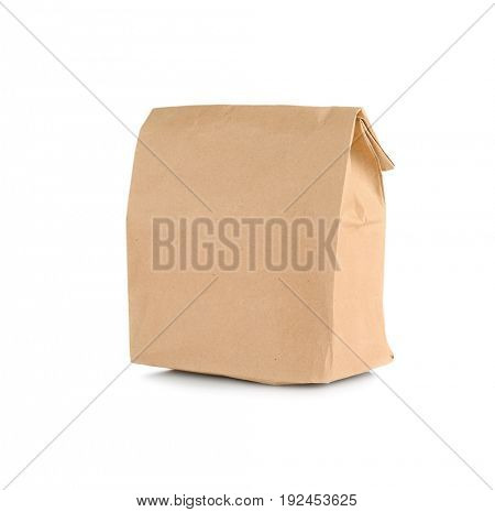 Paper bag with flour on white background