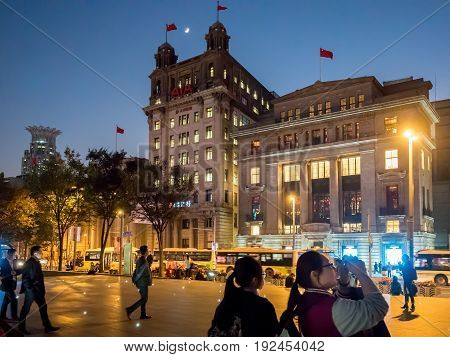 Shanghai, China - Nov 4, 2016: View of North China Daily News (AIA - American Insurance Association) building by night. Along The Bund on Zhongshan East 1st Road.