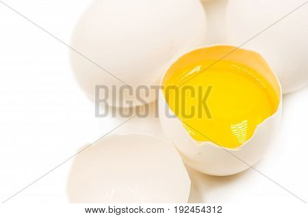 fresh eggs with yellow yalk on the black background