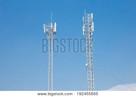 two telecommunication tower with blue sky background.