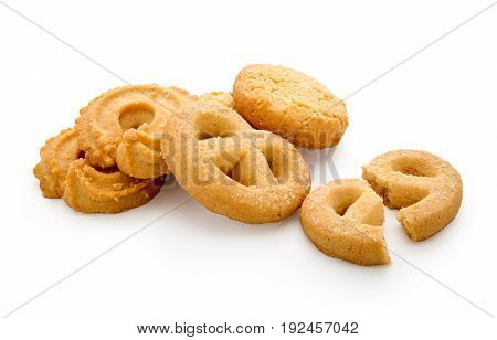 Butter cookies isolated on white background have one broken piece.