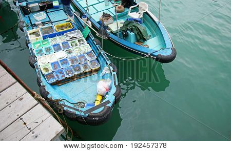 Fishing boat at Sai Kung pier selling live seafood. Hong Kong, china