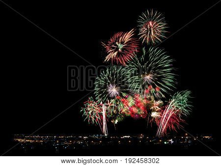 Fireworks lit up over city of big town at night for new year celebration and special occasions with black copy space for text decoration background