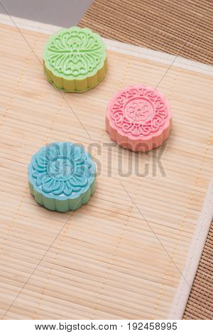 Traditional mooncakes on table setting. Snowy skin mooncakes. Chinese mid autumn festival foods.