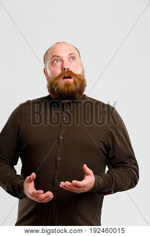 Man with beard looks up