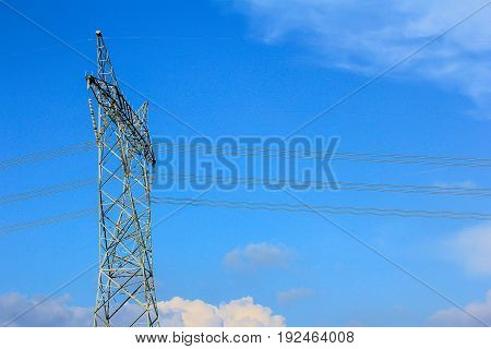 The silhouette of the electricity transmission pylon in daytime outdoors. Electricity Pylon. Russian standard overhead power line transmission tower on the sky background.