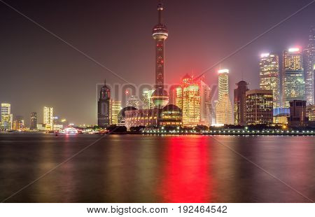 Shanghai, China - Nov 4, 2016: Night view of the Shanghai City skyline. Features the Oriental Pearl TV tower and Huangpu River.