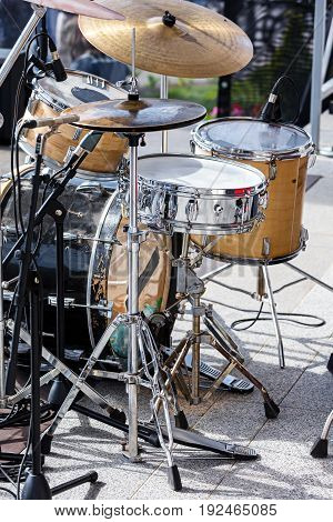 Drum Kit With Microphones Standing On Outdoor Stage