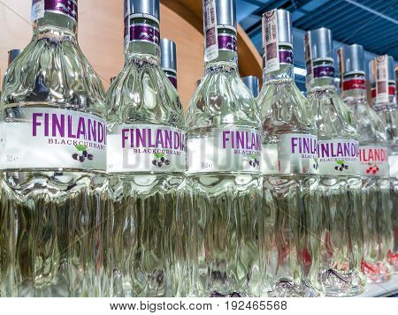 Gorlice Poland - June 23 2017: Variety of Natural Flavoured Finlandia Vodka on store shelves for sale in Kaufland Hypermarket. Finlandia is a famous vodka produced in Finland.