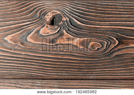 close-up texture larch wood. dark brown countertop or background
