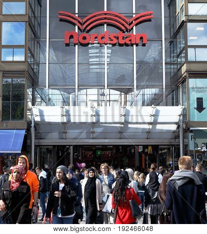 Gothenburg Sweden - May 25 2015: People outside the main entrance to the shopping mall Nordstan in downtown Gothenburg.