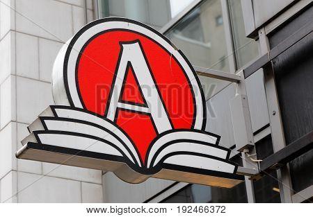 Stockholm Sweden - June 16 2016: The sign and logo for the bookshop Akademibokhandeln at Smalandsgatan in downtown Stockholm.