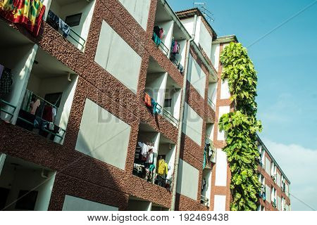 apartment building in sunny day with fabric