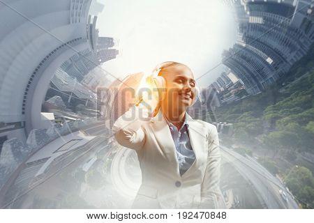 Woman wearing white headphones. Mixed media
