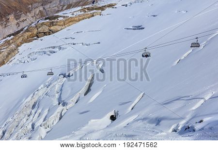 Cable car on Mt. Titlis in Switzerland. The Titlis is a mountain located on the border between the Swiss cantons of Obwalden and Bern, mainly accessed from the town of Engelberg.