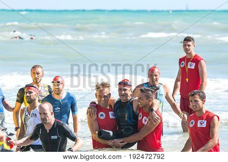 Pescara Italy - June 18 2017: Arrival for the swimming test of disabled athlete Alex Zanardi at Ironman 70.3 Pescara of June 18 2017