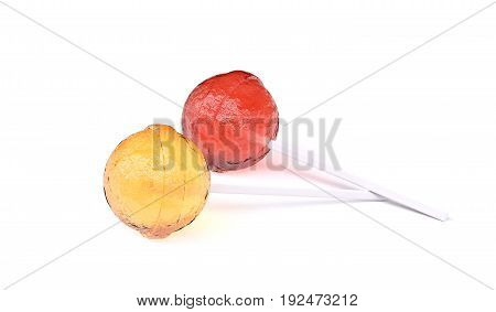 Yellow and red lollipops lying on white background, with soft shadows. 3d image