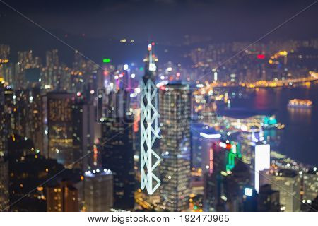Aerial view Hong Kong central business downtown blurred bokeh light night view abstact background