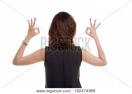 Back View Of Asian Woman Show Double Ok Hand Sign.