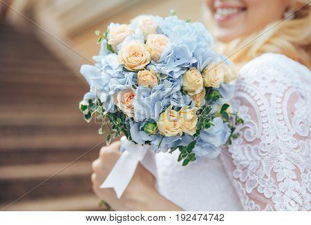 wedding bouquet in hands of bride. Smiling bride