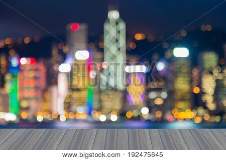 Opening wooden floor Blurred bokeh light Hong Kong city busienss downtown at twilight abstract background