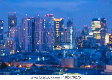Blurred bokeh night light office building at twilight abstract background